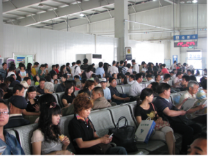 Passengers waiting for their train at Tianjin Station. Image: Lyndsey Biddle