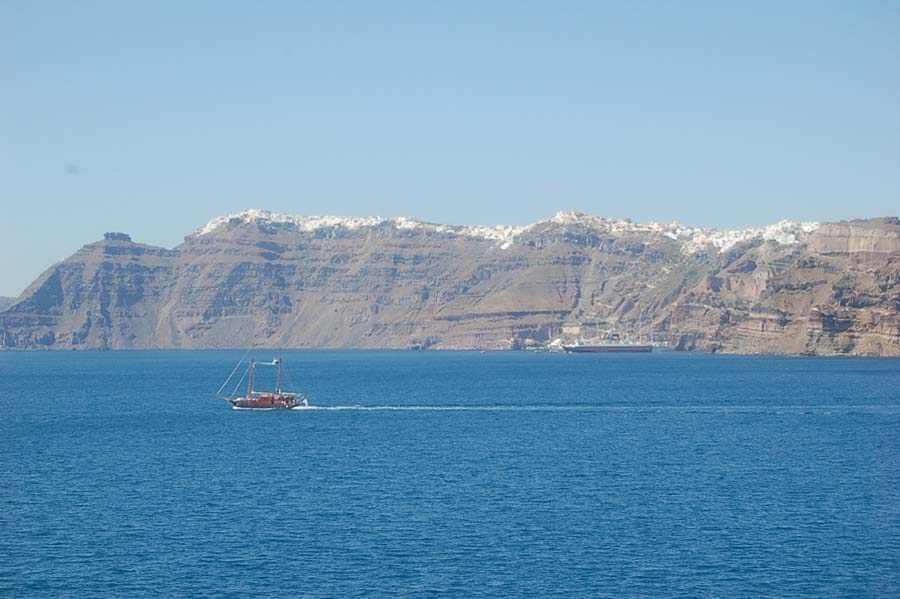 I took this image as our boat approached the island of Santorini. You can see the white buildings perched on craggy cliffs.