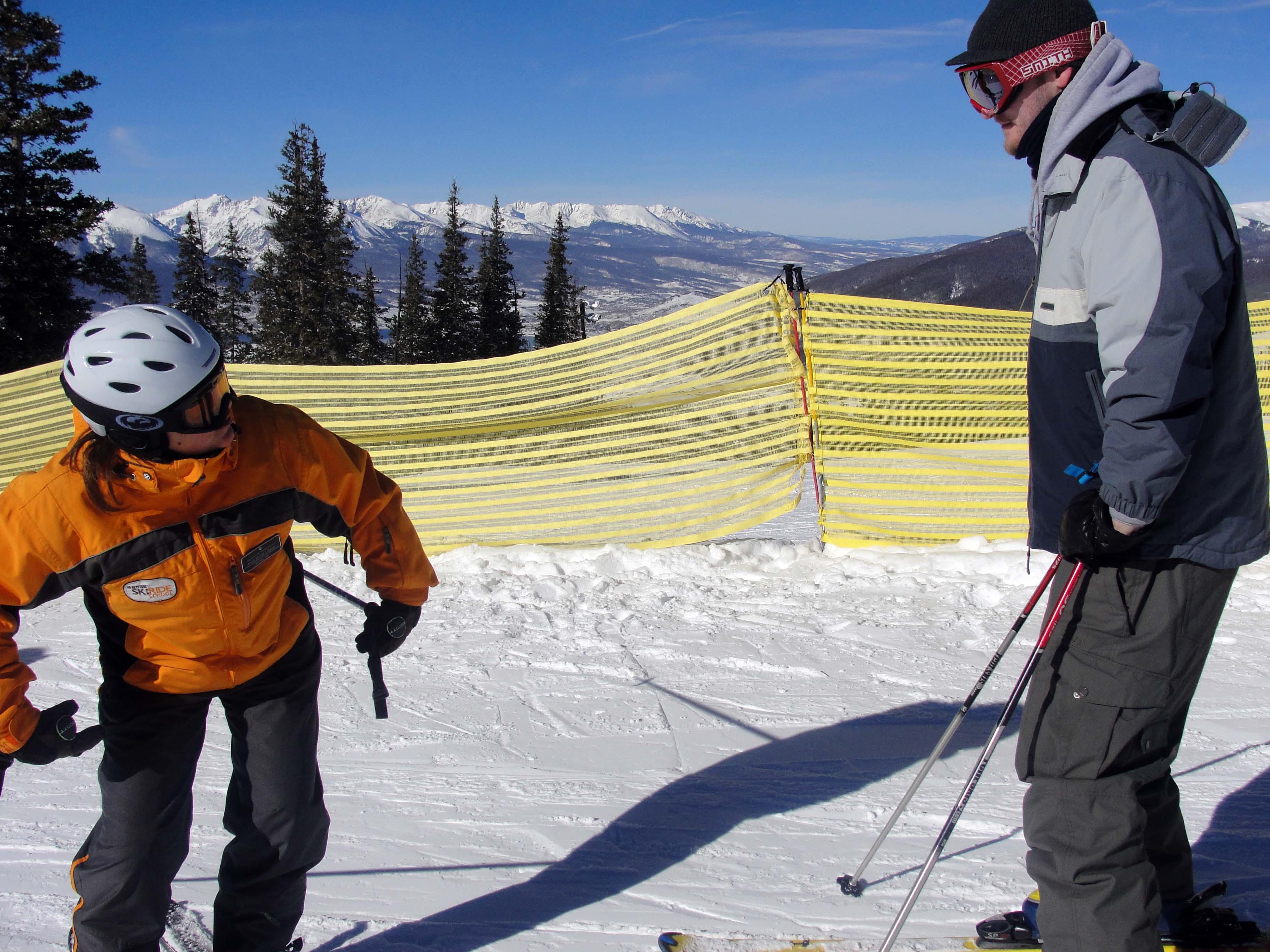 Kim teaching Bryan skiing techniques
