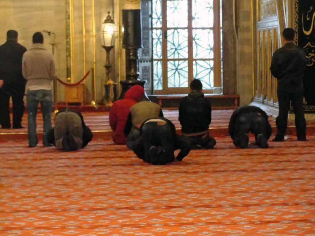 Men praying at Blue Mosque